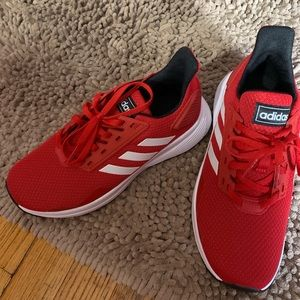 Women's size 6 or Boys size 4. Red Adidas. New